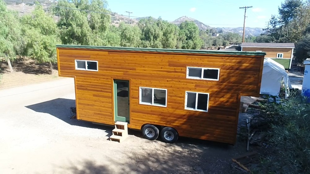 9 x 24 Modern Caravan by Tiny House Cottages professionally built dual lofts washer dryer full kitchen hardwoods composting toilet 1