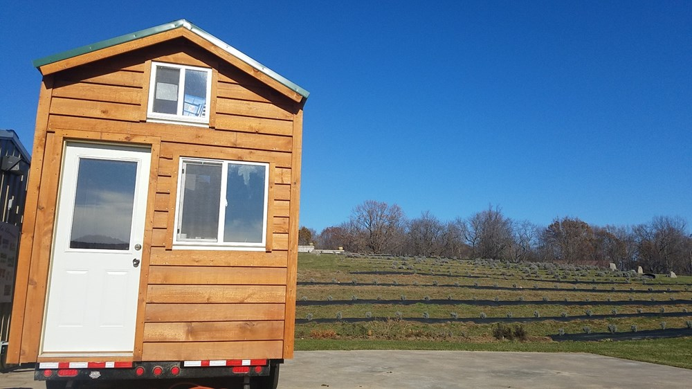 Tiny amish built wooden cabin on wheels 4