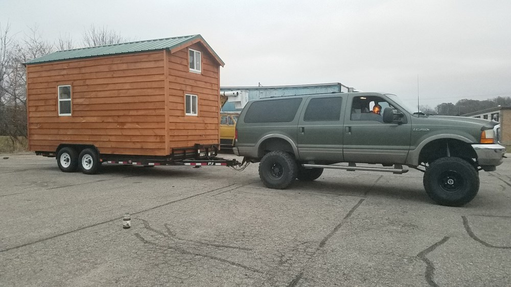 Tiny amish built wooden cabin on wheels 2