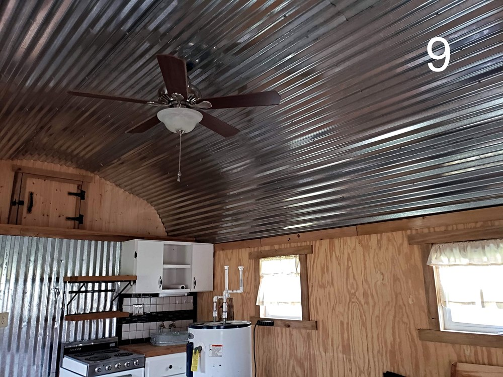 Cabin Style Tiny House with Covered Porch 10