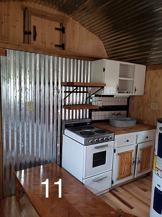 Cabin Style Tiny House with Covered Porch 13