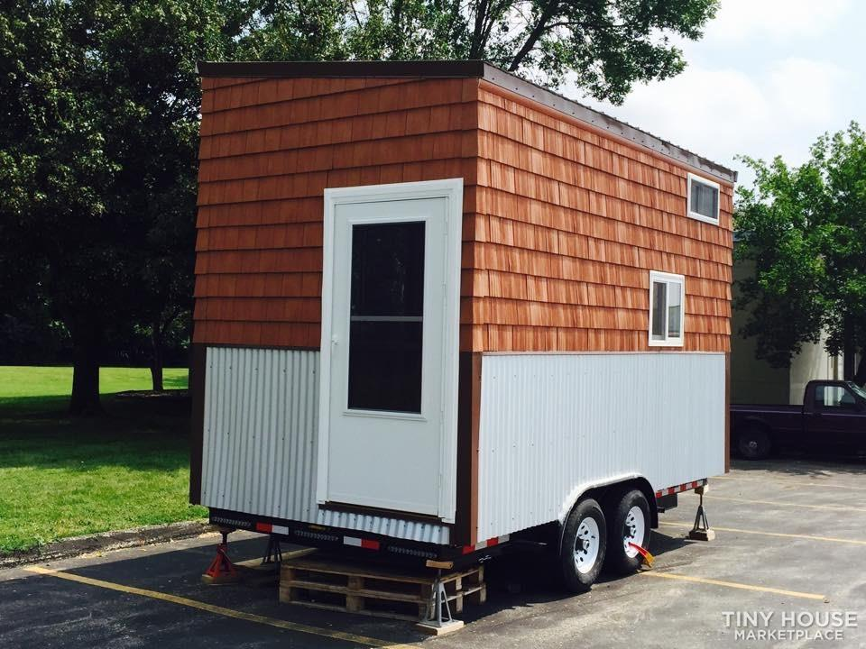 Cedar/Birch Tiny house on wheels loaded with packages