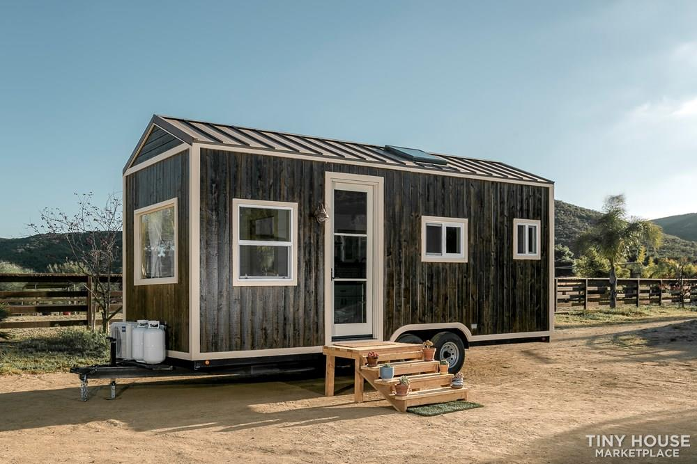 Gorgeous modern meets rustic tiny home on wheels!