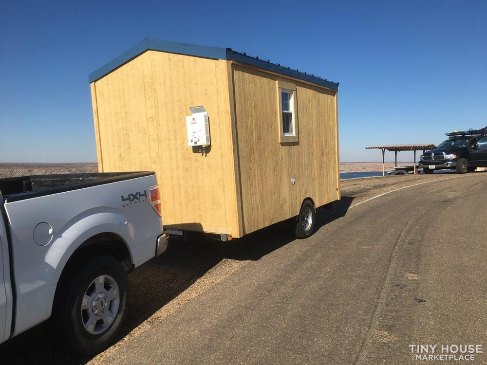 Teenie Tiny house for someone who wants comfort on a budget.  4